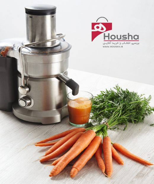 side-view-metallic-professional-juicer-with-glass-filled-with-tasty-juice-breakfast-from-organic-farm-carrots-lying-wooden-table
